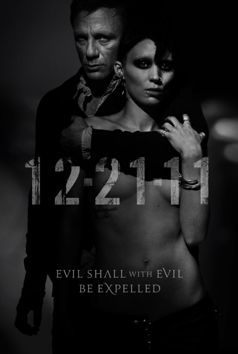 the-girl-with-the-dragon-tattoo-teaser-poster-2011-rooney-mara-pierced ... The Girl With The Dragon Tattoo Poster